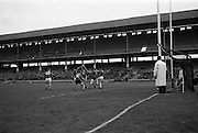 17/03/1967<br /> 03/17/1967<br /> 17 March 1967<br /> Railway Cup Final: Munster v Leinster at Croke Park, Dublin. <br /> A Munster attack is cleared by Leinster's T. Neville (2) while Munster foreward, T. Aherne (17), looks on.