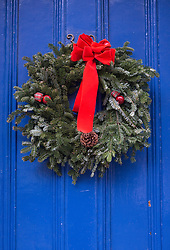 Christmas Wreath on a blue door in New York City