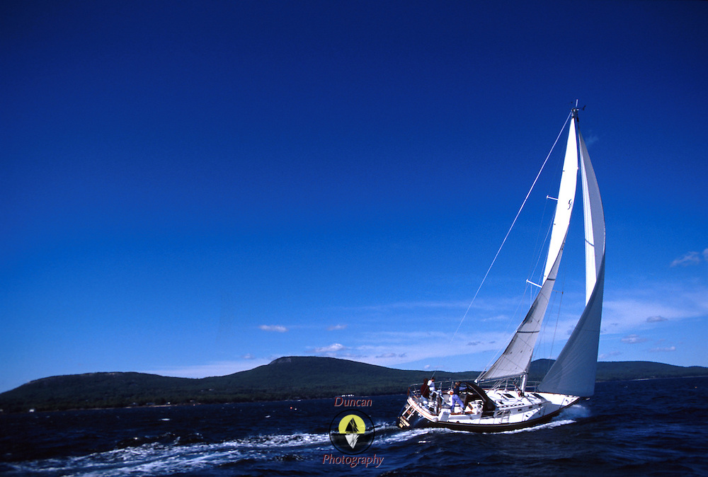 Sloop Owl owned by Spike Thorne sails in Penobscot Bay, Maiene with the Camden Hills in the background..Photo by Roger S. Duncan.  ...