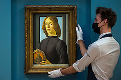 "© Licensed to London News Pictures. 02/12/2020. LONDON, UK.  ""Young Man Holding a Roundel"", 1480, by Sandro Botticelli is displayed at Sotheby's New Bond Street gallery.  The work is the highlight of Sotheby's annual Masters Week sales series in New York taking place in January 2021 and is estimated to sell for in excess of US$80 million, which will establish it in art market history as one of the most significant portraits, of any period, ever to appear at auction.  Photo credit: Stephen Chung/LNP"