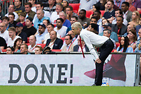 """Arsenal manager Arsene Wenger is seen beside an advertising board saying """"Done!""""       <br /> <br /> <br /> Photographer Craig Mercer/CameraSport<br /> <br /> The Emirates FA Cup Final - Arsenal v Chelsea - Saturday 27th May 2017 - Wembley Stadium - London<br />  <br /> World Copyright © 2017 CameraSport. All rights reserved. 43 Linden Ave. Countesthorpe. Leicester. England. LE8 5PG - Tel: +44 (0) 116 277 4147 - admin@camerasport.com - www.camerasport.com"""
