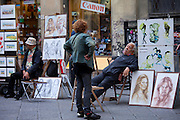 Pavement artists and souvenir stalls in Piazza di San Giovanni, Italy