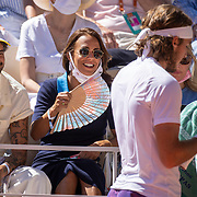PARIS, FRANCE June 13. French actress French actresses Alice Belaidi looks on as Stefanos Tsitsipas of Greece wipes his tennis racquet with a towel during his match against Novak Djokovic of Serbia on Court Philippe-Chatrier during the Men's Singles Final at the 2021 French Open Tennis Tournament at Roland Garros on June 13th 2021 in Paris, France. (Photo by Tim Clayton/Corbis via Getty Images)