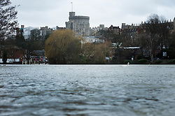 © London News Pictures. 12/02/2014. Windsor, UK.  Flood Water on the River Thames in front of Windsor Castle in Berkshire, where the river has broken it's banks. Photo credit : Ben Cawthra/LNP