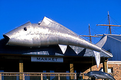 Large metal fish sculpture hanging over a local market in Galveston Texas