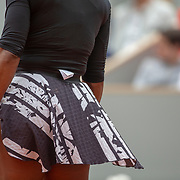 PARIS, FRANCE May 30.   Serena Williams of the United States spent the entire match against Kurumi Nara of Japan with her clothing label hanging out of her back during the Women's Singles second round match on Court Philippe-Chatrier at the 2019 French Open Tennis Tournament at Roland Garros on May 30th 2019 in Paris, France. (Photo by Tim Clayton/Corbis via Getty Images)