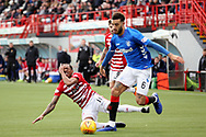 Rangers defender Connor Goldson (6) pushes Hamilton Accademical forward Mickel Miller (11) off the ball and the Hamilton player holds his face during the Ladbrokes Scottish Premiership match between Hamilton Academical FC and Rangers at New Douglas Park, Hamilton, Scotland on 24 February 2019.