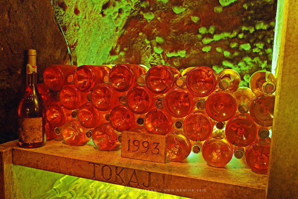 The Oremus winery in Tolcsva, Tokaj: bottles lying in the underground cellar, backlit, giving a wonderful, magical golden-reddish glow. Waiting to mature. 1993 carved in stone. Oremus is owned by the Alvarez family that also owns Vega Sicilia in Spain It is managed by Andras Bacso. Credit Per Karlsson BKWine.com