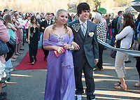 """Ashley Blake and Brandon Alger march through the crowd as they enter Gunstock for Laconia High School's""""Night of Diamonds"""" junior prom Friday evening.  (Karen Bobotas/for the Laconia Daily Sun)"""