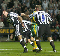 Photo. Glyn Thomas. <br /> Newcastle United v Norwich City. Barclays Premiership.<br /> 25/08/2004.<br /> Newcastle's Aaron Hughes (L) wheels away in delight after scoring his side's second goal
