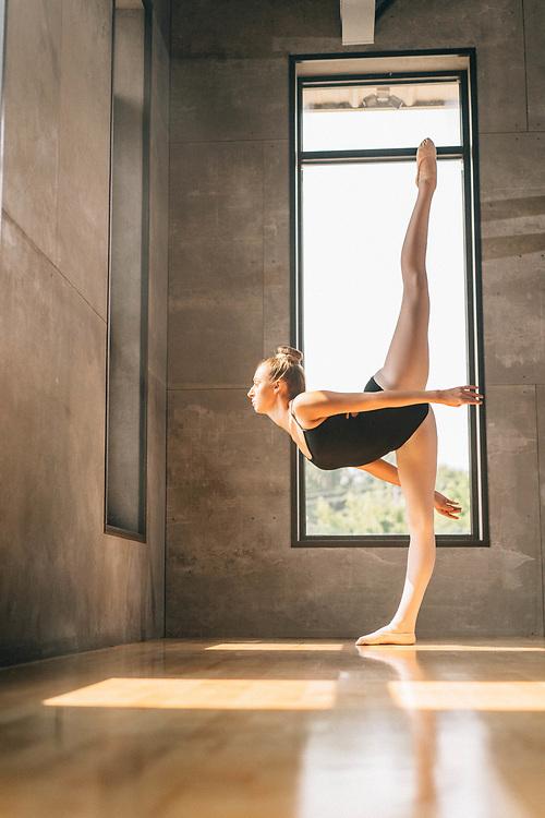 Ballerina dances by a window