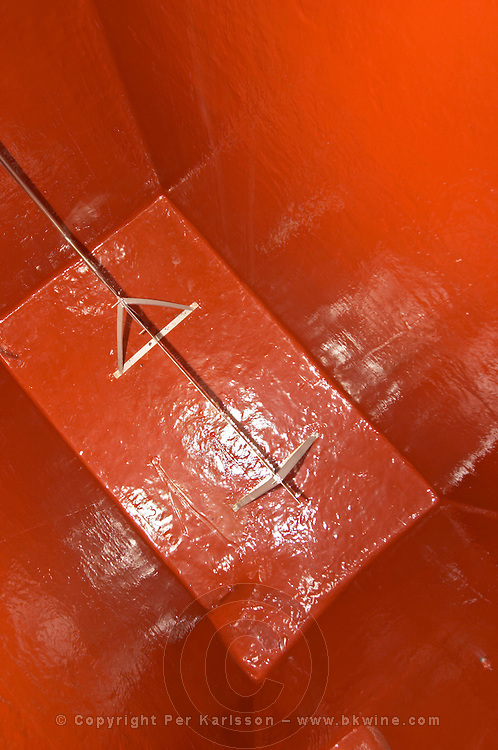 Inside a concrete fermentation tank: painted red and a cooling / heating curtain heat exchanger for temperature control seen from above  Chateau de Pressac St Etienne de Lisse  Saint Emilion  Bordeaux Gironde Aquitaine France