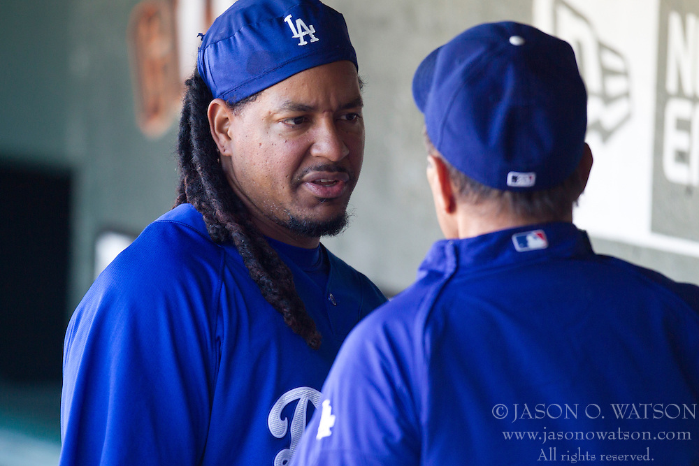 June 29, 2010; San Francisco, CA, USA;  Los Angeles Dodgers left fielder Manny Ramirez (left) talks with manager Joe Torre (right) before the game against the San Francisco Giants at AT&T Park.