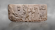 """Aslantepe Hittite Orthostat. Limestone, Aslantepe, Malatya, 1200-700 B.C. <br /> <br /> Scene of offering drink and sacrifice. The god, with a symbol of divinity above, is in the chariot while holding a boomerang in his hand and a sword at his waist. The same god holds a lightning bundle in the middle. On the right, the king offers a drink to god. The inscription above reads """"Great, powerful King Sulumeli"""". A servant stands behind holding a bull for sacrifice to the gods. Anatolian Civilisations Museum, Ankara, Turkey<br /> <br /> Against a grey art background. <br /> <br /> If you prefer to buy from our ALAMY STOCK LIBRARY page at https://www.alamy.com/portfolio/paul-williams-funkystock/hittite-art-antiquities.html . Type - Aslantepe - in LOWER SEARCH WITHIN GALLERY box. Refine search by adding background colour, place, museum etc.<br /> <br /> Visit our HITTITE PHOTO COLLECTIONS for more photos to download or buy as wall art prints https://funkystock.photoshelter.com/gallery-collection/The-Hittites-Art-Artefacts-Antiquities-Historic-Sites-Pictures-Images-of/C0000NUBSMhSc3Oo"""