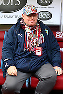 A Burnley fan sitting in the dugout prior to kick off. Barclays Premier league match, Burnley v Everton at Turf Moor in Burnley, Lancs on Sunday 26th October 2014.<br /> pic by Chris Stading, Andrew Orchard sports photography.