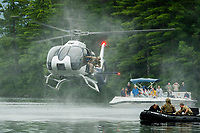 The Navy Seal Team jumps from their helicopter during the mission demonstration at Wellington State Beach at Newfound Lake Friday afternoon.  (Karen Bobotas/for the Laconia Daily Sun)