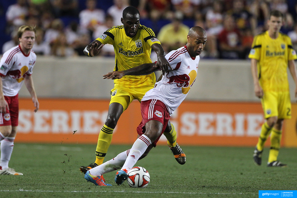 Tony Tchani, (left), Columbus Crew, challenges Thierry Henry, New York Red Bulls, during the New York Red Bulls Vs Columbus Crew, Major League Soccer regular season match at Red Bull Arena, Harrison, New Jersey. USA. 12th July 2014. Photo Tim Clayton