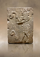 Photo of Hittite monumental relief sculpted orthostat stone panel from Water Gate Basalt, Karkamıs, (Kargamıs), Carchemish (Karkemish), 900-700 B.C. Anatolian Civilisations Museum, Ankara, Turkey. Bull-man holding the trunk of the tree. The waist-down part of the figure is in the form of a bull. <br /> <br /> On a brown art background. .<br />  <br /> If you prefer to buy from our ALAMY STOCK LIBRARY page at https://www.alamy.com/portfolio/paul-williams-funkystock/hittite-art-antiquities.html  - Type  Karkamıs in LOWER SEARCH WITHIN GALLERY box. Refine search by adding background colour, place, museum etc.<br /> <br /> Visit our HITTITE PHOTO COLLECTIONS for more photos to download or buy as wall art prints https://funkystock.photoshelter.com/gallery-collection/The-Hittites-Art-Artefacts-Antiquities-Historic-Sites-Pictures-Images-of/C0000NUBSMhSc3Oo