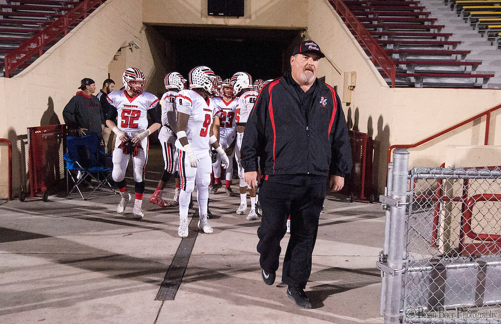 Cordova Lancers head coach Darren Nill, leads his team onto the field before the Sac-Joaquin Section Division I football playoff game between the Christian Brothers Falcons and Cordova Lancers at Huges Stadium,  Friday Nov 11, 2016.<br /> photo by Brian Baer