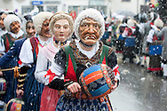 Imst Schemenlaufen, a traditional carnival held only once every four years in Imst, Tirol, Austria (31 January 2016). The Schemenlaufen is inscribed on the UNESCO list of Intangible Cultural Heritage. Pictured, one of the Wifligsackner, who clear the crowd from the procession route by swinging a large 'ball' stuffed with dried corn leaves. © Rudolf Abraham