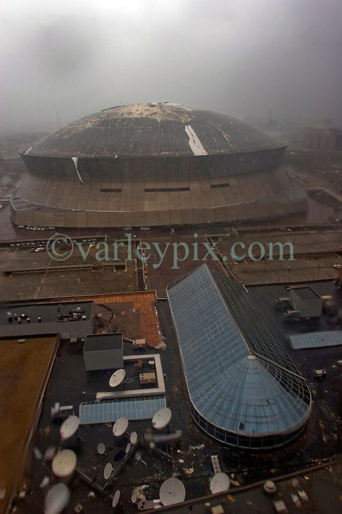 29 August, 2005. New Orleans, Louisiana.<br /> Hurricane Katrina hits New Orleans. The new roof on the Superdome is stripped as the storm passes over.<br /> Photo; Charlie Varley.