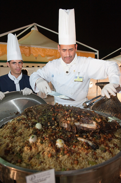 """Oman Food Festival 2012 and featured some of the leading chefs from Oman Tourism College..Picture shows; shuwa, an Omani delicacy (sometimes over two days) prepared in an underground clay oven. The meat becomes extremely soft after it is marinated with spices and herbs before cooking to give it a very distinct taste..© Mark Lloyd images  Stage One Tour of Oman: .Winner of the Stage:.71 GREIPEL Andre - Lotto Belisol Team .Time 3hr25'59"""" .2nd place - Denis GALIMZYANOV  - KAT(Russia) - 3hr26'03"""".3rd place - Tyler FARRAR - GRM  (USA) - 3hr26'05"""" .General Individual Time Classification (Red Jersey): .71 GREIPEL Andre - Lotto Belisol Team .Points Classifcation (Green Jersey):.71 GREIPEL Andre - Lotto Belisol Team .Young Rider Classification (White Jersey):-.32 GALIMZYANOV Denis - Katusha Team .Most Aggressive Rider Classification .143 LEMAIR Alexandre - Bridgestone Anchor .© Mark Lloyd images"""