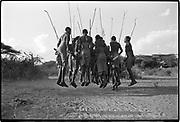 If you can talk, you can sing; if you can walk, you can dance.  Zimbabwean proverb<br /> <br /> Maasai men dancing a traditional warrior dance. Northern Kenya 1990