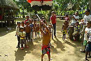 Over the last quarter-century, a few Embera families pushed further North of Darien, settling in the jungles bordering the Ipeti? River -- a scant two-hour journey from cosmopolitan Panama City. Embera communities are scattered in this border wilderness. Pictured: Children playing a traditional game called ¨Pin?ata¨.