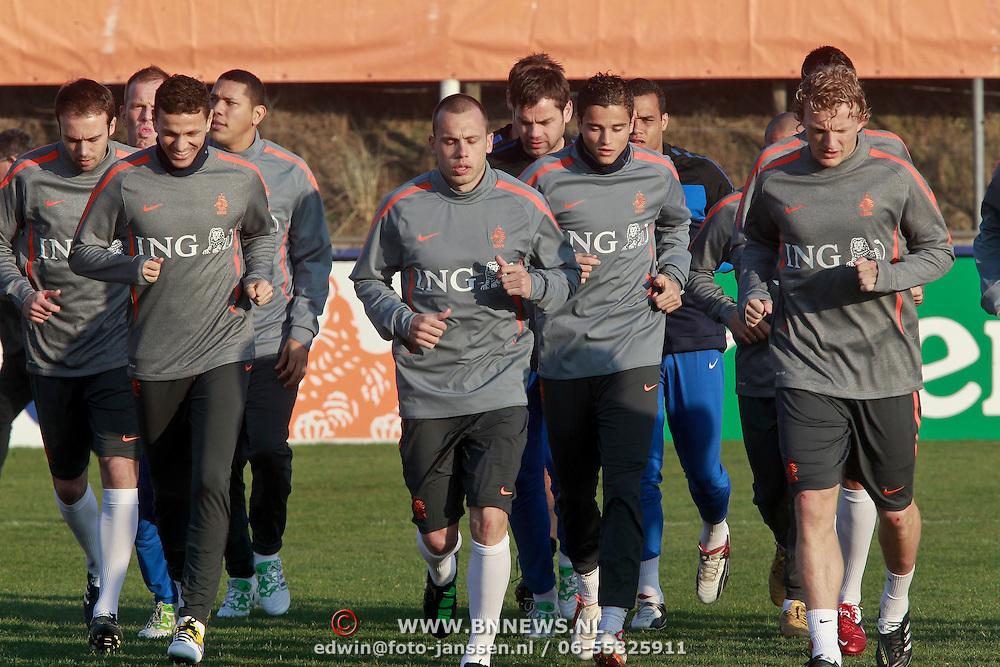 NLD/Katwijk/20110321 - Training Nederlandse Elftal Hongarije - NLD, warming up, Khalid Boularouz, Wesley Sneijder, Ibrahim Affalay, Dirk Kuyt