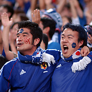 Japanese fans celebrate their second goal