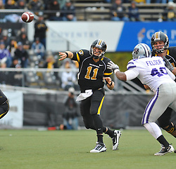 Nov 13, 2010; Columbia, MO, USA; Missouri Tigers quarterback Blaine Gabbert (11) throws a pass in the second half as Kansas State Wildcats defensive end Antonio Felder (40) attempts coverage at Memorial Stadium. Missouri won 38-28.  Mandatory Credit: Denny Medley-US PRESSWIRE