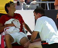 Tennis; MELBOURNE, AUSTRALIA - JANUARY 19:  John Van Lottum of Holland receives treatment to his thigh after collapsing  to the floor with cramp during his match against Gustavo Kuerten of Brazil during day one of the Australian Open January 19, 2004 in Melbourne, Australia.