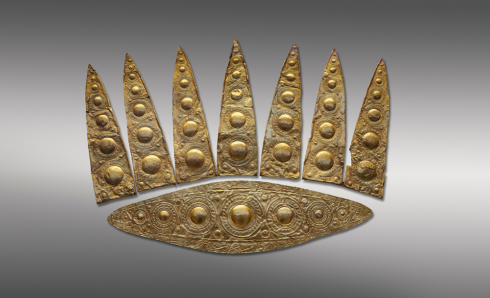 Top leaf shapes of a Mycenaean gold diadem from Grave III, 'Grave of a Women', Grave Circle A, Myenae, Greece. National Archaeological Museum Athens. Grey Background<br /> <br /> Cat No 3,5. 16th century BC.<br /> <br /> Shaft Grave III, the so-called 'Grave of the Women,' contained three female and two infant interments. The women were literally covered in gold jewelry and wore massive gold diadems, while the infants were overlaid with gold foil. .<br /> <br /> If you prefer to buy from our ALAMY PHOTO LIBRARY  Collection visit : https://www.alamy.com/portfolio/paul-williams-funkystock/mycenaean-art-artefacts.html . Type -   Athens    - into the LOWER SEARCH WITHIN GALLERY box. Refine search by adding background colour, place, museum etc<br /> <br /> Visit our MYCENAEN ART PHOTO COLLECTIONS for more photos to download  as wall art prints https://funkystock.photoshelter.com/gallery-collection/Pictures-Images-of-Ancient-Mycenaean-Art-Artefacts-Archaeology-Sites/C0000xRC5WLQcbhQ