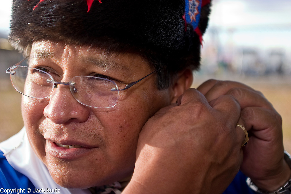 10 SEPTEMBER 2004 - WINDOW ROCK, AZ: A man prepares for the pow-wow at the 58th annual Navajo Nation Fair in Window Rock, AZ. The Navajo Nation Fair is the largest annual event in Window Rock, the capitol of the Navajo Nation, the largest Indian reservation in the US. The Navajo Nation Fair is one of the largest Native American events in the United States and features traditional Navajo events, like fry bread making contests, pow-wows and an all Indian rodeo. The Wooly Ride, also called Mutton Busting, is a rodeo for children six years old and younger. The youngsters are set on a sheep which is then turned loose in the arena. Points are awarded for style and length of ride. Wooly Riding is extremely popular on the Navajo reservation, which has a strong cattle and sheep ranching tradition.  PHOTO BY JACK KURTZ
