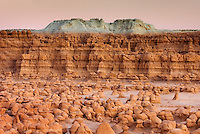 Odd shaped hoodoos of Entrada Sandstone illuminated in evening afterglow, Goblin Valley State Park Utah USA