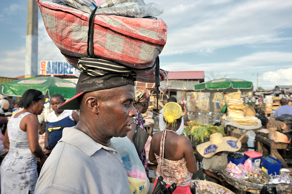 A man walks through the Croix-des-Bossales market in the La Saline neighborhood of Port-au-Prince, Haiti.