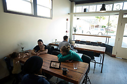 Customers relax with their beverages at Devout Coffee, Tuesday, April 5, 2016, in Fremont, Calif. (Photo by D. Ross Cameron)