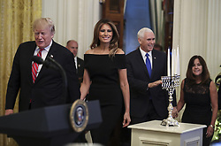 President Donald Trump with first lady Melania Trump, Vice President Mike Pence and his wife Karen Pence, walk to the East Room of the White House during a Hanukkah reception on December 6, 2018 in Washington, DC. Behind Trump, Vice President Mike Pence. (Photo by Oliver Contreras/SIPA USA)
