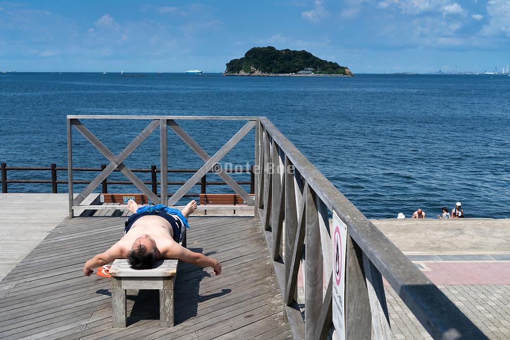 sunbathing at Umikaze park, Yokosuka with Tokyo Bay and Sarushima Island