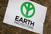 Extinction Rebellion Earth protector sign as the camp starts to take shape in Waterloo Millennium Green on 16th July in London, England, United Kingdom. Extinction Rebellion is a climate change group started in 2018 and has gained a huge following of people committed to peaceful protests. These protests are highlighting that the government is not doing enough to avoid catastrophic climate change and to demand the government take radical action to save the planet.