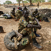 April 24, 2012 - Lalop, South Sudan: A group of SPLA soldiers rest at the newly established military base in the village o Lalop, 50 kilometers north of Bentiu...South Sudan and their northern neighbors, Sudan, have in the past two weeks been involved in heavily clashes over border disputes. Bentiu and neighboring villages have been under constant bombardment by the troops os Karthoum , who established their positions around 10 kilometers into South Sudan's territory. The international community is concerned about the possibility of a full on war between the two countries.