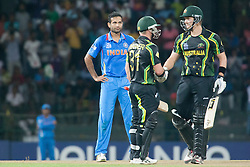 © Licensed to London News Pictures. 28/09/2012. Irfan Pathan looks on in dismay after being hit for two sixes as David Warner congratulates Shane Watson on making 50 runs during the T20 Cricket World cup match between Australia Vs India at the R.Premadasa Cricket Stadium,Colombo. Photo credit : Asanka Brendon Ratnayake/LNP