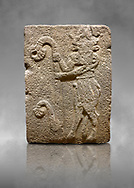 Hittite monumental relief sculpted orthostat stone panel from Water Gate Basalt, Karkamıs, (Kargamıs), Carchemish (Karkemish), 900-700 B.C. Anatolian Civilisations Museum, Ankara, Turkey. Bull-man holding the trunk of the tree. The waist-down part of the figure is in the form of a bull. <br /> <br /> On a grey art background. .<br />  <br /> If you prefer to buy from our ALAMY STOCK LIBRARY page at https://www.alamy.com/portfolio/paul-williams-funkystock/hittite-art-antiquities.html  - Type  Karkamıs in LOWER SEARCH WITHIN GALLERY box. Refine search by adding background colour, place, museum etc.<br /> <br /> Visit our HITTITE PHOTO COLLECTIONS for more photos to download or buy as wall art prints https://funkystock.photoshelter.com/gallery-collection/The-Hittites-Art-Artefacts-Antiquities-Historic-Sites-Pictures-Images-of/C0000NUBSMhSc3Oo