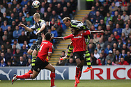 Peter Crouch of Stoke city climbs on Kevin Theophile-Catherine of Cardiff  to win a header. Barclays Premier league match, Cardiff city  v Stoke city at the Cardiff city stadium in Cardiff, South Wales on Saturday 19th April 2014. pic by Mark Hawkins, Andrew Orchard sports photography,