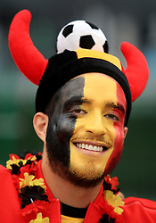 A Belgium fan in face paint and a horned hat