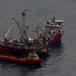 Vessels work at the site of the Deepwater Horizon oil spill in the Gulf of Mexico near the coast of Louisiana, U.S., on Wednesday, June 2, 2010. BP Plc has given up trying to plug its leaking well in the Gulf of Mexico any sooner than August, laying out a series of steps to pipe the oil to the surface and ship it ashore for refining, said Thad Allen, the U.S. government's national commander for the incident. Photographer: Derick E. Hingle