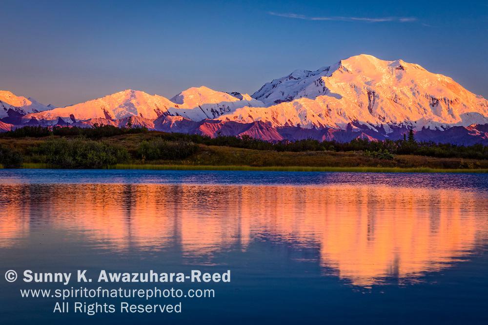 Close up of Mt. Denali (McKinley) reflects on Reflection Pond at sunset, Denali National Park & Preserve, Interior Alaska, Autumn.