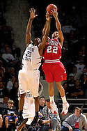 Texas Tech guard Jarrius Jackson (22) and Kansas State forward Cartier Martin (20) reach up for a long rebound in the second half at Bramlage Coliseum in Manhattan, Kansas, January 8, 2007.  Texas Tech beat K-State 62-52.
