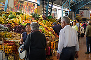 The market in Cotacachi,Ecuador,where people are shopping for fresh fruits and vegetables.