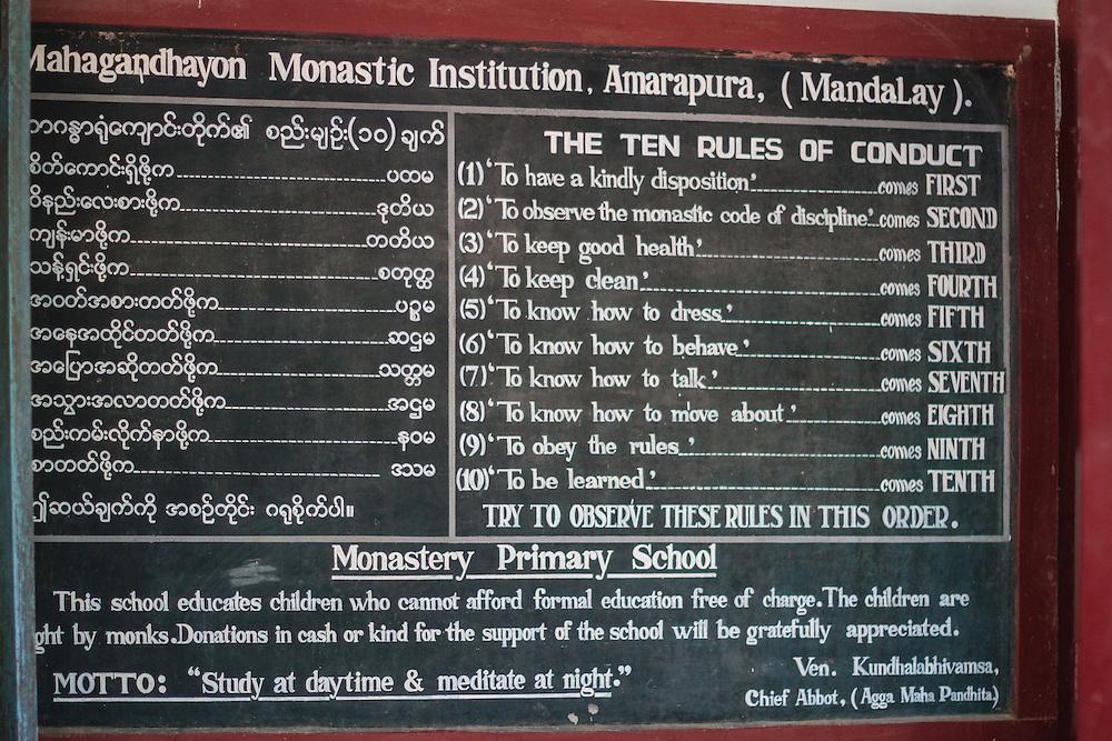 Monastery primary school rules on chalkboard in Mandalay school.